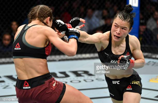 Zhang Weili of China punches Joanna Jedrzejczyk of Poland in their UFC strawweight championship fight during the UFC 248 event at TMobile Arena on...