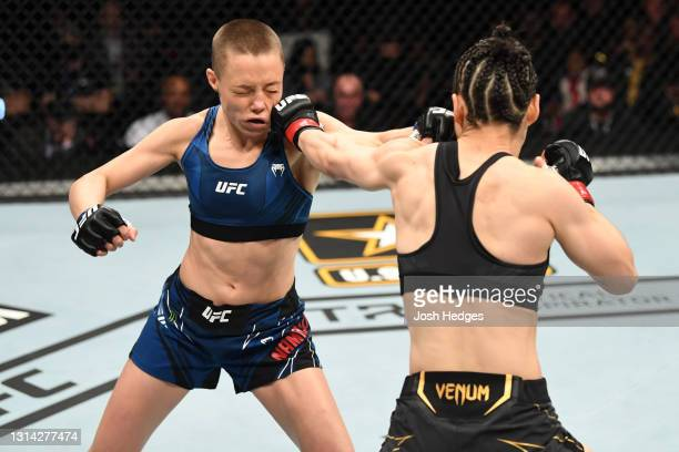Zhang Weili of China punches Rose Namajunas in their UFC women's strawweight championship bout during the UFC 261 event at VyStar Veterans Memorial...