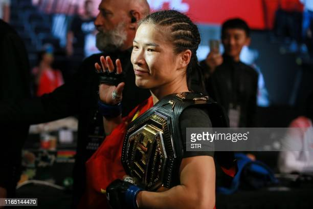Zhang Weili of China waves after defeating Jessica Andrade of Brazil in their UFC mixed martial arts bout in Shenzhen Guangdong province on August 31...