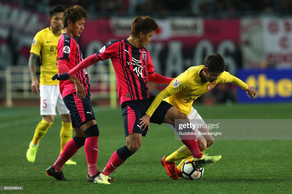 Zhang Wenzhao of Guangzhou Evergrande and Yusuke Maruhashi of Cerezo Osaka compete for the ball during the AFC Champions League Group G match between Cerezo Osaka and Gunazhou Evergrande at the Yanmar Stadium Nagai on February 21, 2018 in Osaka, Japan.