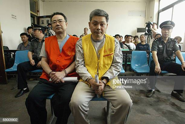 Zhang Xiaochuan and his younger brother Zhang Tiansheng stand trial on corruption charges on June 1 2005 in Xian Shaanxi Province China Zhang...