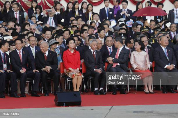 Zhang Xiaoming director of the Liaison Office of the Central People's Government in Hong Kong from second left Tung CheeHwa Hong Kong's former chief...