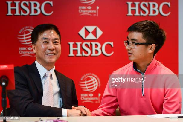 Zhang Xiaoning China Golf Association President and Zecheng Dou Chinese player at the PGA TOUR press conference during the WGC HSBC Champions at...