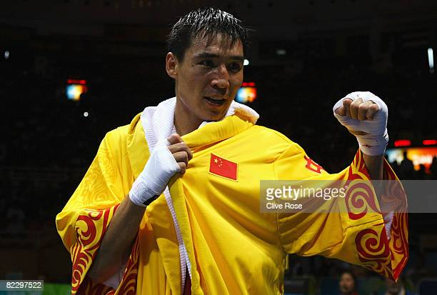 Zhang Xiaoping of China celebrates his victory against Artur Beterbiev of Russia in the Men's Light Heavy at the Workers' Gymnasium during Day 6 of...
