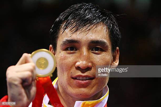 Zhang Xiaoping of China celebrates with his gold medal after defeating Kenny Egan of Ireland in the Men's Light Heavy Final Bout held at the Workers'...