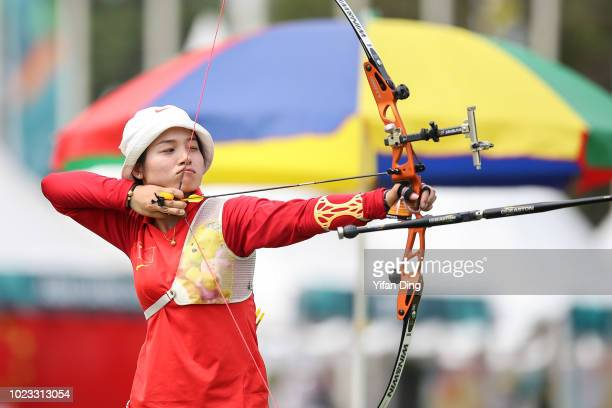 Zhang Xinyan of China in action during Archery Recurve Women's Team Quarterfinal between China and Kazakhstan on day seven of the Asian Games on...