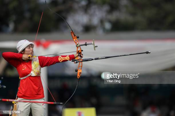 Zhang Xinyan of China in action during Archery Recurve Women's Team Semifinal between China and Chinese Taipei on day seven of the Asian Games on...