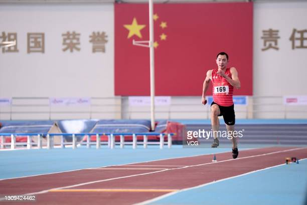 Zhang Yaoguang of Liaoning competes in the Men's Long Jump final during a national indoor invitational event in preparation for the Olympic Games...