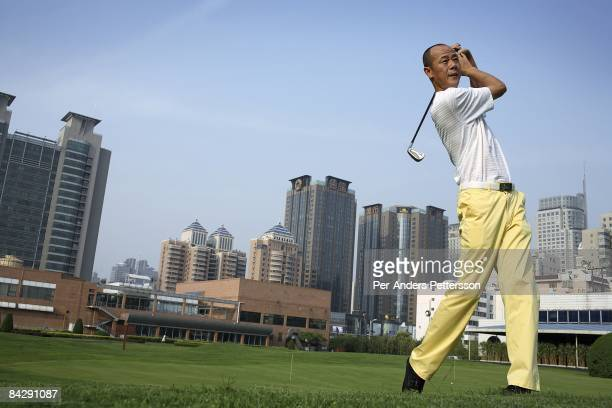 Zhang Yi age 44 a director for an insurance company with 200 employees plays golf at the Xian Country Club on June 2 2007 in central Xian China Zhang...