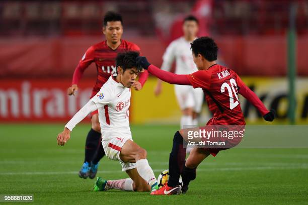 Zhang Yi of Shanghai SIPG and Kento Misao of Kashima Antlers compete for the ball during the AFC Champions League Round of 16 first leg match between...