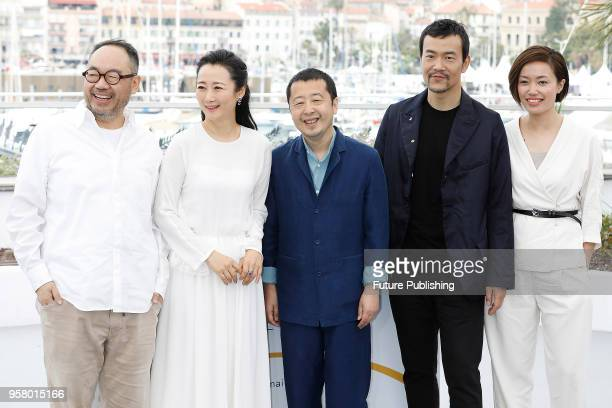 Zhang Yibai Zhao Tao director Jia ZhangKe Liao Fan and guest at the 'Ash Is The Purest White ' photocall during the 71st Cannes Film Festival at the...