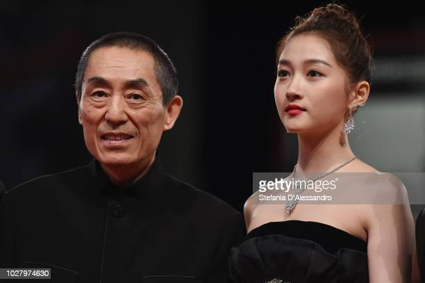 Zhang Yimou and Guan Xiaotong walk the red carpet ahead of the Ying and 2018 JaegerLeCoultre Glory to the Filmaker Award to Zhang Yimou during the...