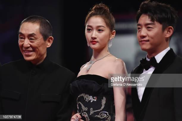 Zhang Yimou Guan Xiaotong and Zhang Kai walk the red carpet ahead of the Ying and 2018 JaegerLeCoultre Glory to the Filmaker Award to Zhang Yimou...