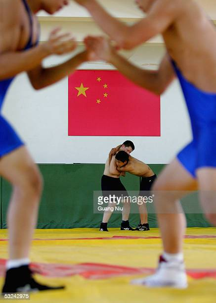 Zhang Yingsong 16 yearsold and Yang Zhengrong 13 yearsold train during a wrestling course of Sports School of Dongcheng District on July 14 2005 in...