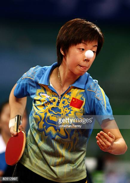Zhang Yining of China plays a shot during the Women's Singles Table Tennis Final against Wang Nan of China held at the Peking University Gymnasium on...
