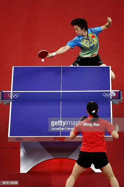 Zhang Yining of China plays a shot during the Women's Singles Table Tennis Final against Wang Nan of China held at the Peking University Gymnasium on...
