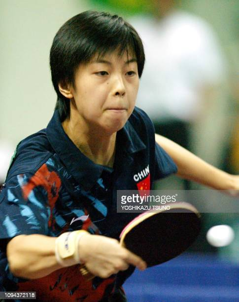 Zhang Yining of China returns the ball against North Korea's Kim Hyon Hui during the final of the table tennis women's team event at the 14th Busan...