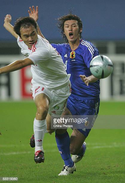 Zhang Yonghai of China vies for a ball with Seiichiro Maki of Japan during a match in the East Asian Football Championship on August 3, 2005 in...