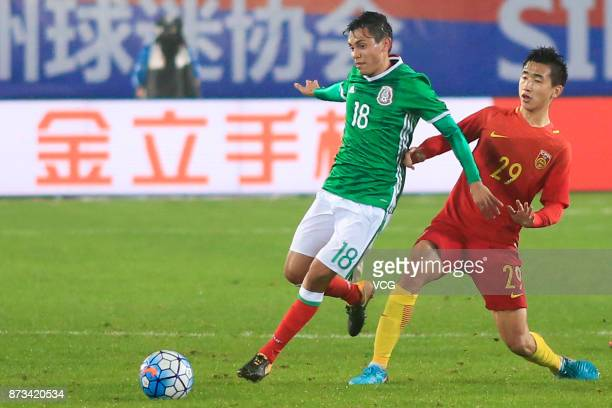 Zhang Yuan of China and Ibarra de la Rosa Javier Eduardo of Mexico vie for the ball during the CFA International Youth Football Tournament Duyun 2017...