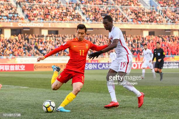 Zhang Yuan of China fights for the ball with Almoez Ali of Qatar during the AFC U23 Championship China 2018 Group A match between China and Qatar at...