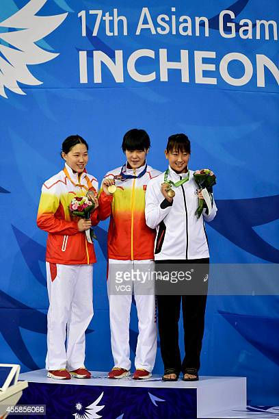 Zhang Yuhan and Bi Yirong of China win gold and siver medal in the final of women's freestyle 400m during day two of the 2014 Asian Games at Munhak...