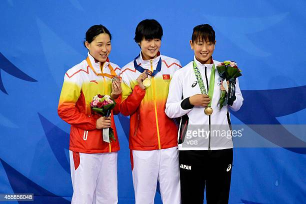 Zhang Yuhan and Bi Yirong of China wins gold and siver medal in the final of women's freestyle 400m during day two of the 2014 Asian Games at Munhak...