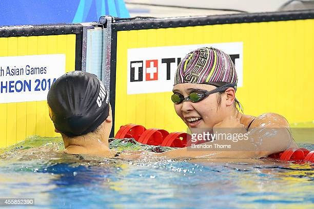 Zhang Yuhan of China celebrates with Bi Yirong of China after winning gold in the Women's 400m Freestyle during day two of the 2014 Asian Games at...