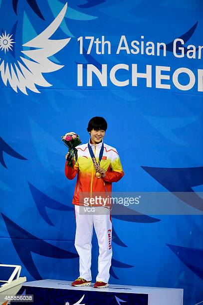 Zhang Yuhan of China wins gold in the final of women's freestyle 400m during day two of the 2014 Asian Games at Munhak Park Taehwan Aquatics Center...