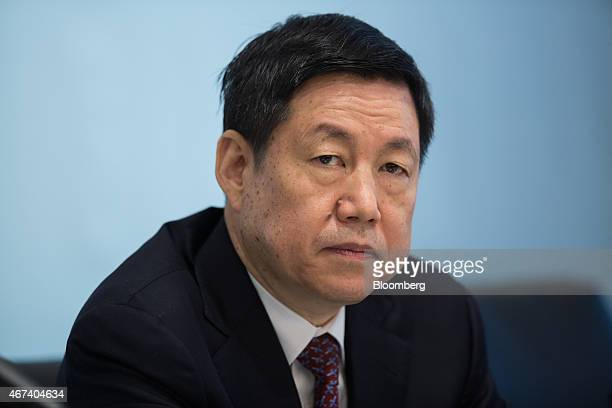 Zhang Yun president and vice chairman of Agricultural Bank of China Ltd pauses during a news conference in Hong Kong China on Tuesday March 24 2015...
