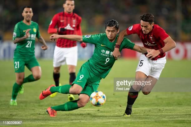 Zhang Yuning of Beijing Guoan and Tomoaki Makino of Urawa Red Diamonds in action during the AFC Champions League Group G match between Beijing Guoan...