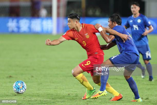 Zhang Yuning of China in action against Camelo Tacusalme of Philippines during the CFA Team China International Football Match between China National...