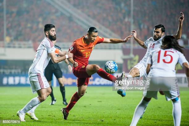 Zhang Yuning of China PR battles for the ball with Ahmad Al Saleh and Tamer Mohamd of Syria during their 2018 FIFA World Cup Russia Final...