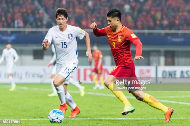 Zhang Yuning of China PR battles for the ball with Hong Jeongho of Korea Republic during their 2018 FIFA World Cup Russia Final Qualification Round...