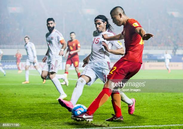 Zhang Yuning of China PR fights for the ball with Alaa Al Shbbli of Syria during their 2018 FIFA World Cup Russia Final Qualification Round Group A...