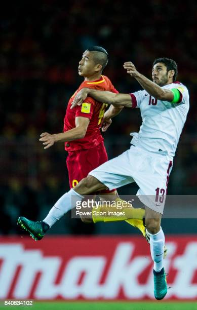 Zhang Yuning of China PR fights for the ball with Ibrahim Majed of Qatar during the 2018 FIFA World Cup Russia Asian Qualifiers Final Qualification...