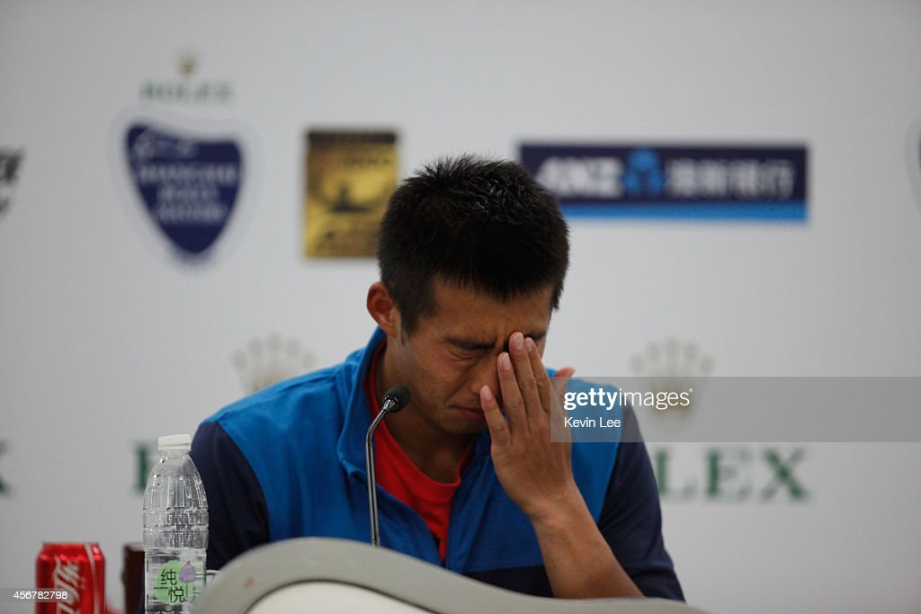 Zhang Ze of China gestures at a press conference during day 3 of the Shanghai Rolex Masters at Zi Zhong stadium on October 7, 2014 in Shanghai, China. Julien Benneteau of France defeats Zhang Ze by 5-7, 6-3, 6-3.