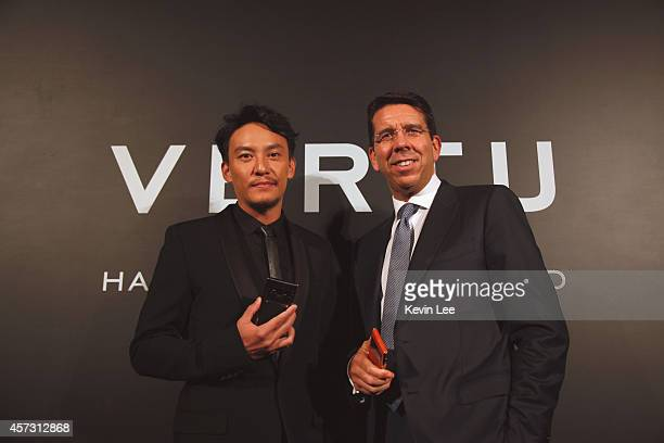 Zhang Zhen and Massimiliano Pogliani poses for a picture at the Vertu Aster Launch party on October 16, 2014 in Shanghai, China.