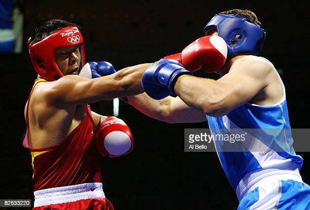 Zhang Zhilei of China and Roberto Cammarelle of Italy fight during the Men's Super Heavy Final Bout held at the Workers' Indoor Arena during Day 16...