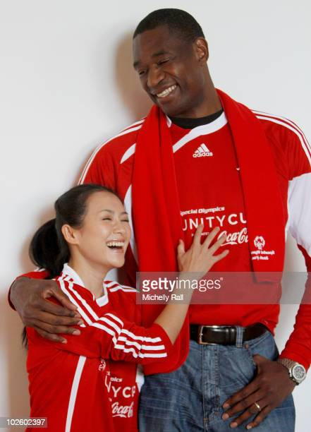 Zhang Ziyi Chinese Actress and Dikembe Mutumbo NBA Legend at the Crystal Towers Hotel before participating in the Special Olympics Unity Cup Match...