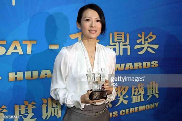Zhang Ziyi poses with the trophy during the 2010 Hua Ding Movie Award at Beijing Wukesong Culture and Sports Center on March 1 2011 in Beijing China