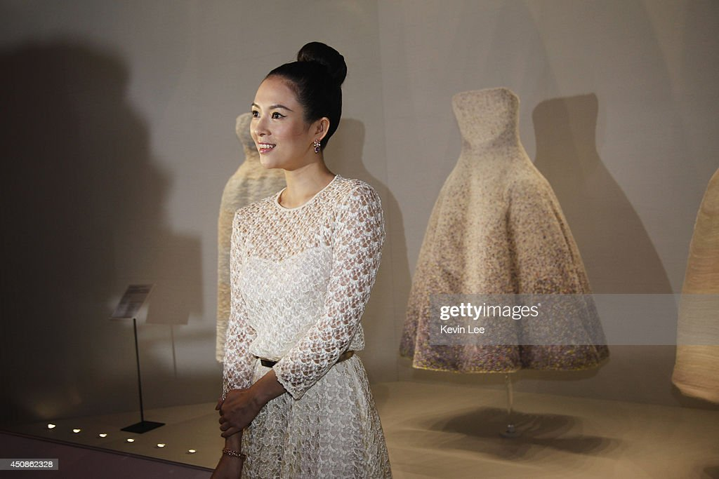 Zhangh Ziyi view the Miss Dior Exhibition on June 19, 2014 in Shanghai, China.
