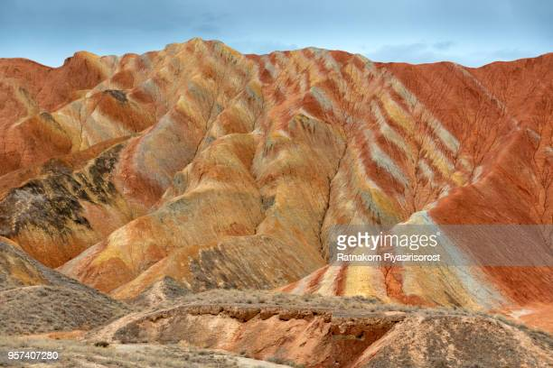 Zhangye Danxia National Geopark, Gansu, China. Colorful landscape of rainbow mountains. Walking paths around sandstone rock formation at Zhangye National Geological Park.