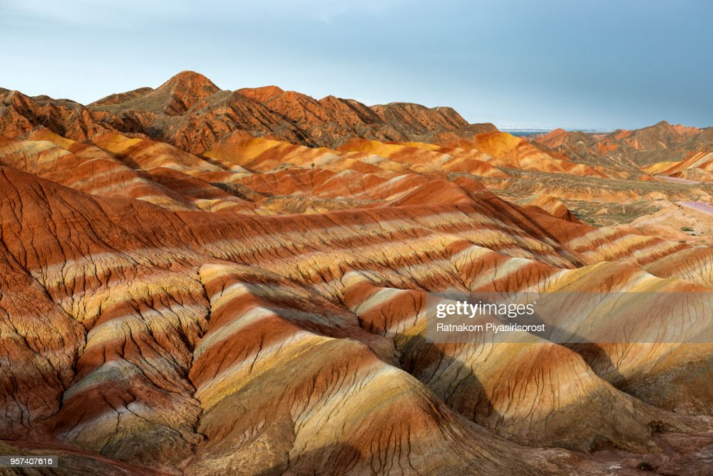 Zhangye Danxia National Geopark, Gansu, China. Colorful landscape of rainbow mountains. Walking paths around sandstone rock formation at Zhangye National Geological Park. : ストックフォト