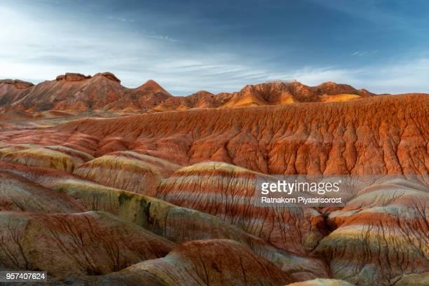 zhangye danxia national geopark, gansu, china. colorful landscape of rainbow mountains. walking paths around sandstone rock formation at zhangye national geological park. - 丹霞地形 ストックフォトと画像