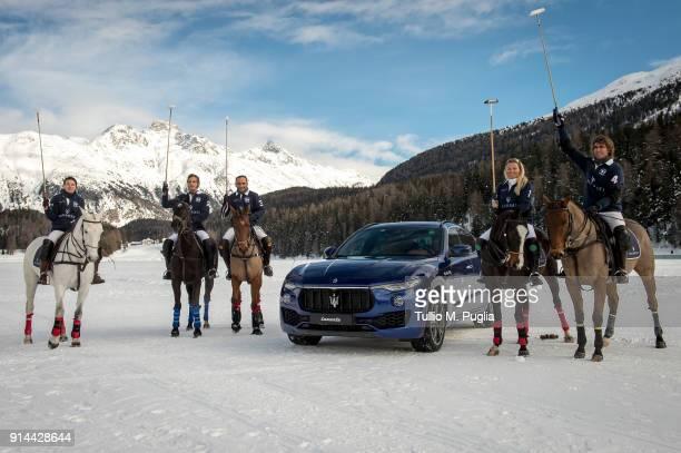 Zhanna Bandurko Gerardo Mazzini Hissam al Hyder Raya Sidorenko and Robert Strom of team Maserati pose near a Maserati Levante during Snow Polo World...