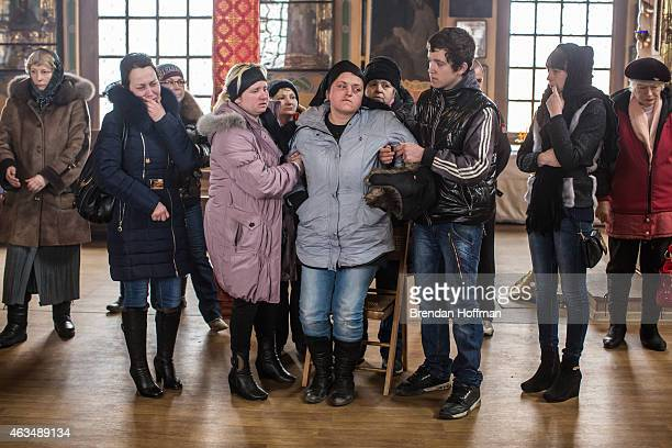 Zhanna Molodetskykh attends the funeral of her son Igor Molodetskykh who was killed two days prior when a shell hit his school on February 15 2015 in...
