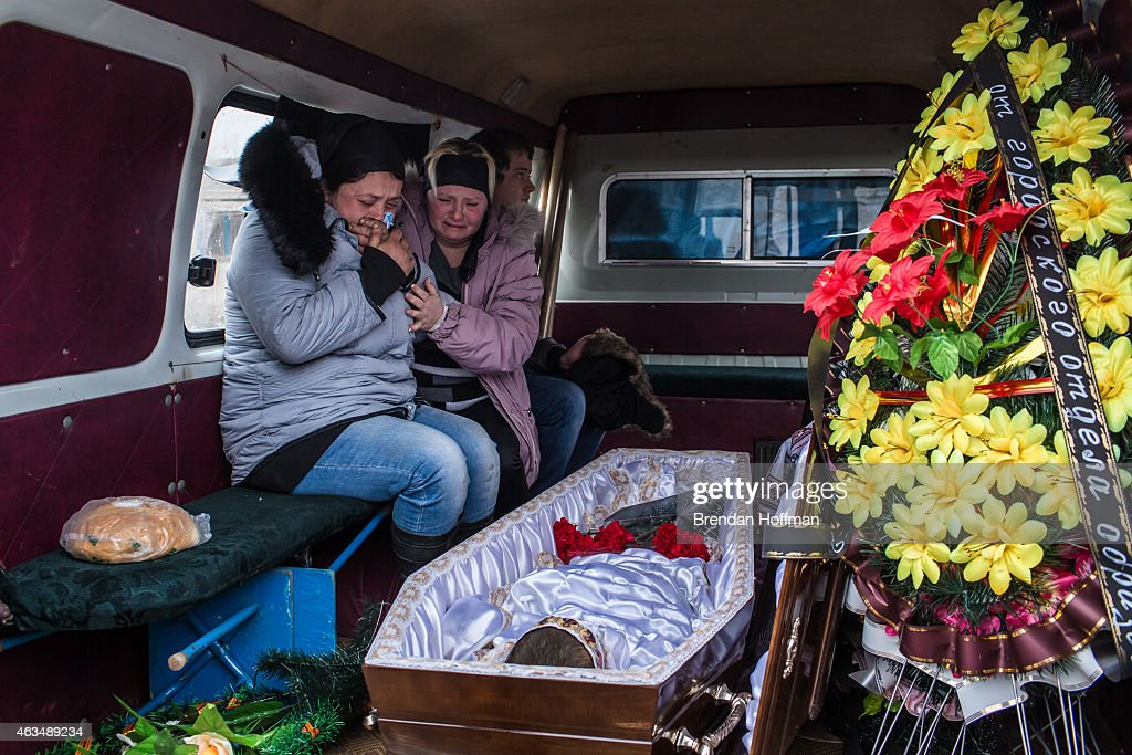 Zhanna Molodetskykh (L) cries over the casket of her son Igor Molodetskykh, 7, who was killed two days prior when a shell hit his school on February 15, 2015 in Artemivsk, Ukraine. A ceasefire scheduled to go into effect at midnight was reportedly observed along most of the front, save for near the embattled town of Debaltseve.