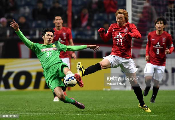 Zhao Hejing of Beijing Guoan and Naoki Ishihara of Urawa Red Diamonds compete for the ball during the AFC Champions League Group G match between...