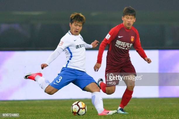Zhao Honglve of Tianjin Teda and Hu Rentian of Hebei China Fortune compete for the ball during the 2018 Chinese Football Association Super League...