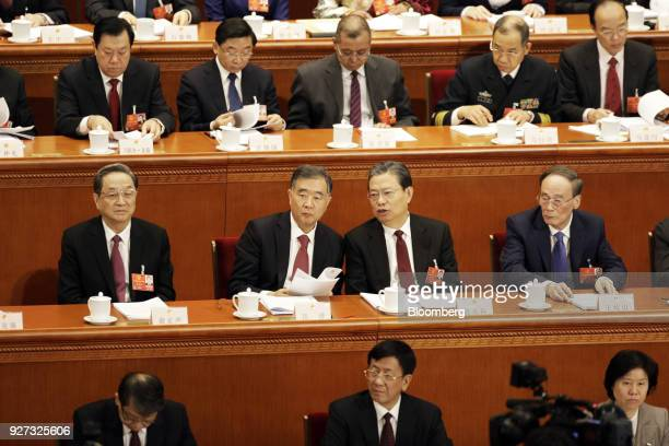 Zhao Leji China's secretary of the Central Commission for Discipline Inspection second row second right speaks with Wang Yang China's vice premier...